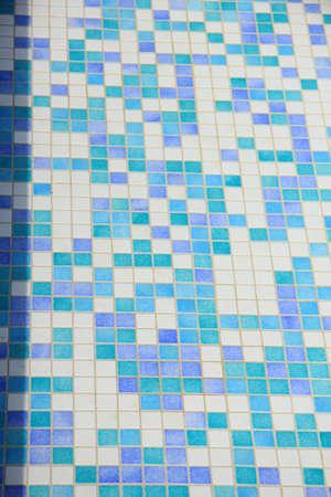 Mosaic tile floor near a swimming pool photo