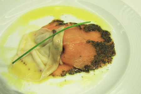 Slice of sword fish with gravat lax smoked salmon with herbs and olive oil