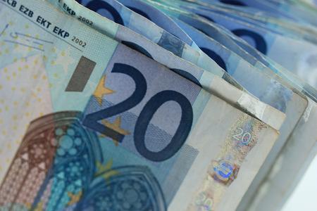 20 euro: Close up of stacked 20 euro banknotes