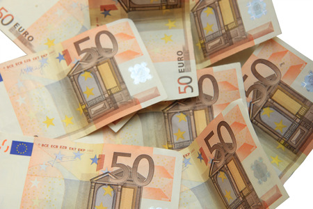 euro notes: Fifty euro notes, spead over a table