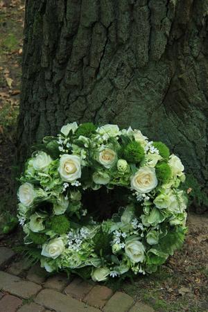 sympathy: Sympathy wreath near a tree
