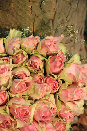 the greenish: Wedding table centerpiece with pink greenish roses