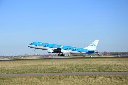 schiphol: March, 22nd 2015, Amsterdam Schiphol Airport PH-EZZ KLM Cityhopper Embraer ERJ-190 take off from Polderbaan Runway
