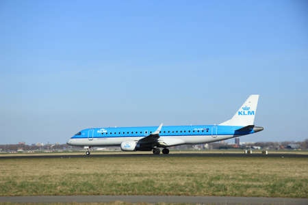 klm: March, 22nd 2015, Amsterdam Schiphol Airport PH-EZP KLM Cityhopper Embraer ERJ-190 take off from Polderbaan Runway Editorial
