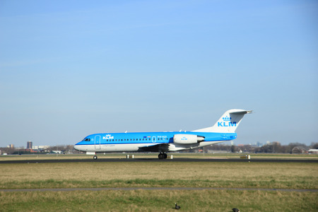 polderbaan: March, 22nd 2015, Amsterdam Schiphol Airport PH-KZI KLM Cityhopper Fokker F70  take off from Polderbaan Runway