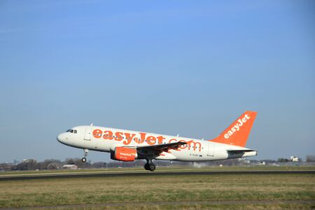 polderbaan: March, 22nd 2015, Amsterdam Schiphol Airport G-EZBC easyJet Airbus A319-111 take off from Polderbaan Runway Editorial