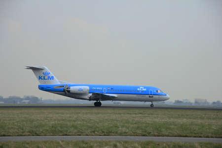 klm: March, 24th 2015, Amsterdam Schiphol Airport  PH-WXD KLM Cityhopper Fokker F70  landing on Polderbaan Runway
