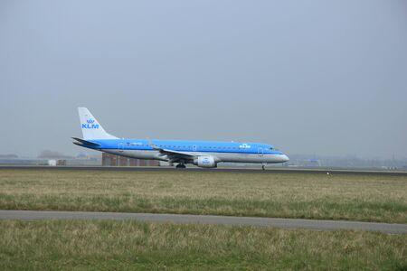 schiphol: March, 24th 2015, Amsterdam Schiphol Airport  PH-EZL KLM Cityhopper Embraer ERJ-190  landing on Polderbaan Runway