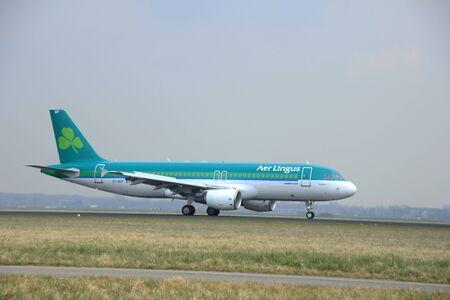 schiphol: March, 24th 2015, Amsterdam Schiphol Airport  EI-DEP Aer Lingus Airbus A320-200   landing on Polderbaan Runway