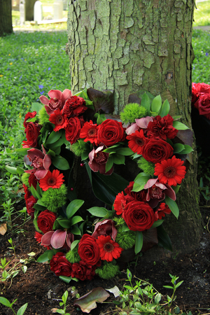 green flower: red roses in a heart shaped sympathy arrangement
