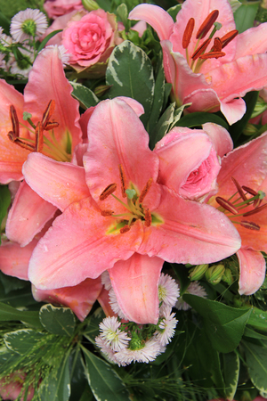 tiger lily: Pink tiger lily in a bridal arrangement