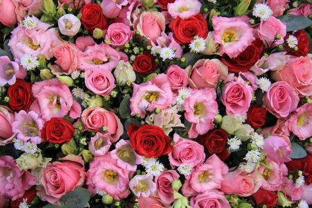 red pink: Red, pink and white flowers in a mixed wedding arrangement Stock Photo