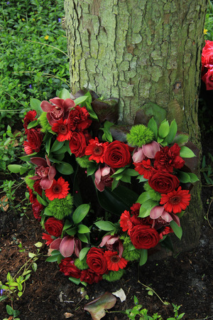 sympathy: red roses in a heart shaped sympathy arrangement
