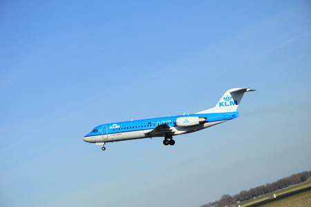 polderbaan: March, 22nd 2015, Amsterdam Schiphol Airport PH-KZK KLM Cityhopper Fokker F70  take off from Polderbaan Runway Editorial