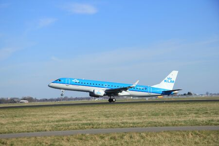 klm: March, 22nd 2015, Amsterdam Schiphol Airport PH-EZZ KLM Cityhopper Embraer ERJ-190 take off from Polderbaan Runway