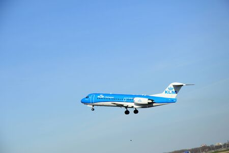 schiphol: March, 22nd 2015, Amsterdam Schiphol Airport PH-KZM   KLM Cityhopper Fokker F70  take off from Polderbaan Runway Editorial
