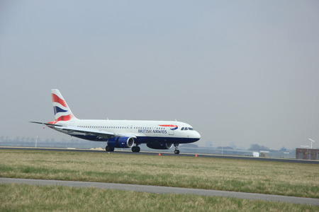 airways: March, 24th 2015, Amsterdam Schiphol Airport  G-EUYN British Airways Airbus A320-200   landing on Polderbaan Runway Editorial