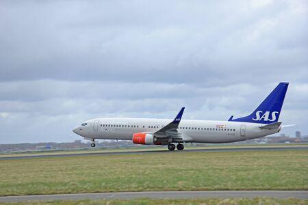 schiphol: March, 27th 2015, Amsterdam Schiphol Airport LN-RGE SAS Scandinavian Airlines Boeing 737-800  Polderbaan Runway Editorial