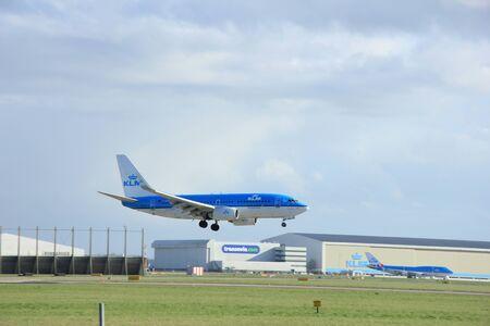 klm: Schiphol Amsterdam, The Netherlands, march 31, 2015: PH-BGP KLM Royal Dutch Airlines Boeing 737-7K2   approaching on runway 0927 Buitenveldert Editorial