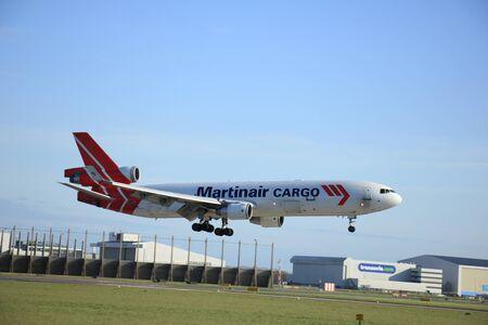 schiphol: Schiphol Amsterdam, The Netherlands, april 11, 2015: PH-MCY Martinair Holland McDonnell Douglas MD-11F  approaching runway 0927 Buitenveldert