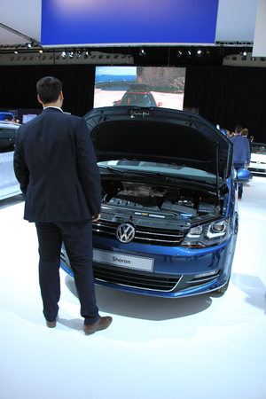 admired: Amsterdam, The Netherlands - April 23, 2015: Volkswagen Sharan admired by potential buyer at the 2015 Amsterdam AutoRAI motorshow. The 2015 Amsterdam motorshow was running from April 17 until April 26, in the RAI event center in Amsterdam, The Netherlands Editorial