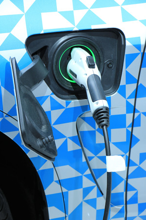 environmental friendly: Environmental friendly hybrid car on recharge Stock Photo