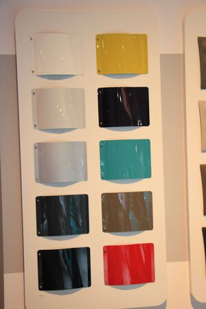 paint samples: Car paint samples on display in a dealer showroom