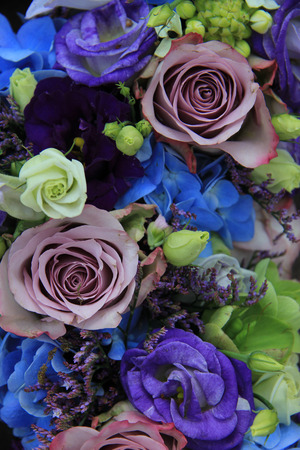 Blue Hydragea And Purple Roses In A Blue Purple Wedding Bouquet