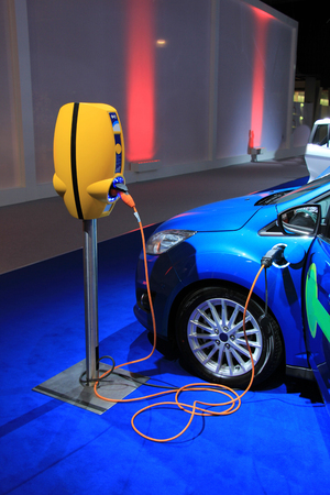 recharge: Environmental friendly hybrid car on recharge Stock Photo