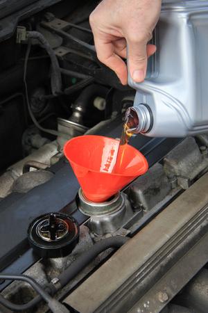 refilling: Refilling engine oil of an older car