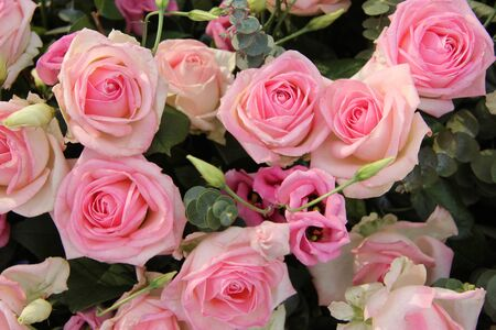 centerpiece: Lisianthus and roses in a pink wedding centerpiece