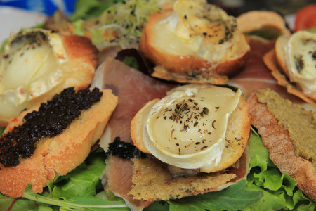 egg plant: Goat cheese salad with tomato and egg plant caviar Stock Photo