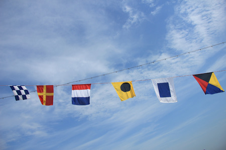 Colorful signal or nautical flags on a cruise ship photo