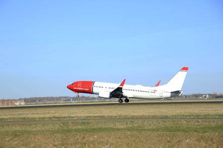 schiphol: March, 22nd 2015, Amsterdam Schiphol Airport LN-NGO Norwegian Air Shuttle Boeing 737-800  take off from Polderbaan Runway
