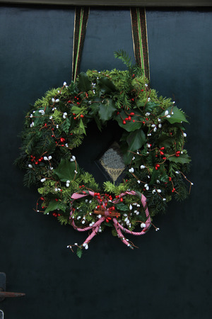 Classic christmas wreath with decorations on a door
