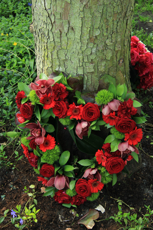 sympathy flowers: red roses in a heart shaped sympathy arrangement