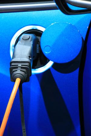 autos: Environmental friendly hybrid car on recharge Stock Photo