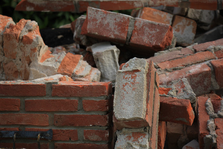 dumpster: Bricks in a dumpster near a construction site, home renovation Stock Photo