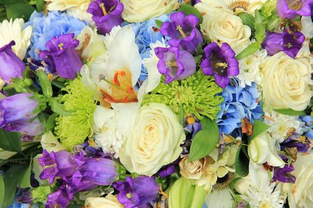 White roses and blue purple flowers in a wedding flower arrangement stock photo white roses and blue purple flowers in a wedding flower arrangement mightylinksfo