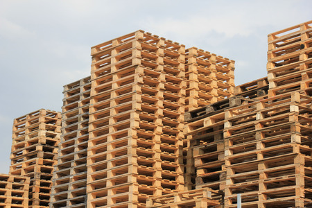 stackable: Stacked wooden pallets at a pallet storage Stock Photo