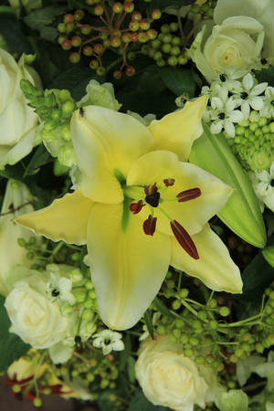 tiger lily: yellow tiger lily in a bridal arrangement