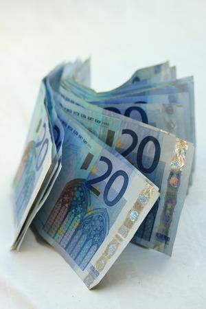 20 euro: stacked 20 euro banknotes on white background Stock Photo