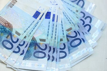 twenty: Twenty euro notes, spead over a table