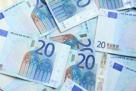 euro notes: Twenty euro notes, spead over a table