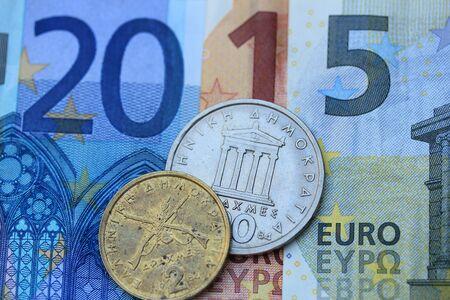 greek coins: Greek Euro crisis 2015: vintage Greek Drachma coins on Euro notes