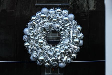 silver ribbon: Silver christmas wreath with decorations on a door