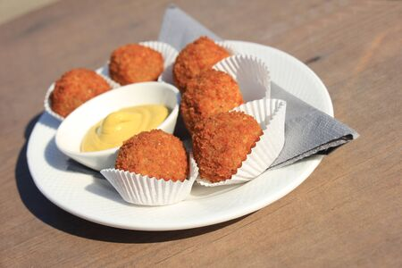 fried snack: Bitterballen with mustard, warm fried snack, served in the Netherlands