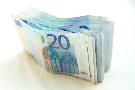20 euro: stacked 20 euro banknotes on white