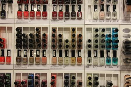 nailpolish: Nailpolish in all colors of the rainbow, displayed in a store