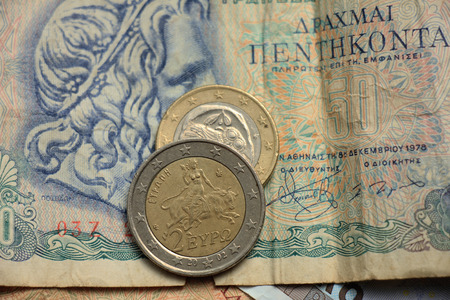 greek coins: Greek euro coins on a vintage greek bank note Stock Photo